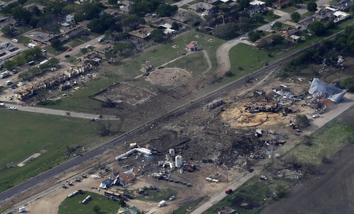 This aerial photo shows the remains of a fertilizer plant and an apartment complex to the left, destroyed by an explosion in West, Texas, Thursday, April 18, 2013. The massive explosion at the West Fertilizer Co. killed as many as 15 people and injured more than 160, officials said overnight. (AP Photo/Tony Gutierrez)