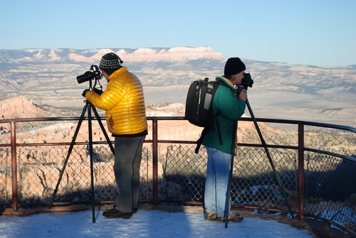 Brian Maffly | The Salt Lake Tribune Wintertime visitors wait for the sunset to photograph the views from Inspiration Point in Bryce Canyon National Park, which is struggling to accommodate increasing traffic congestion in the peak summer season.