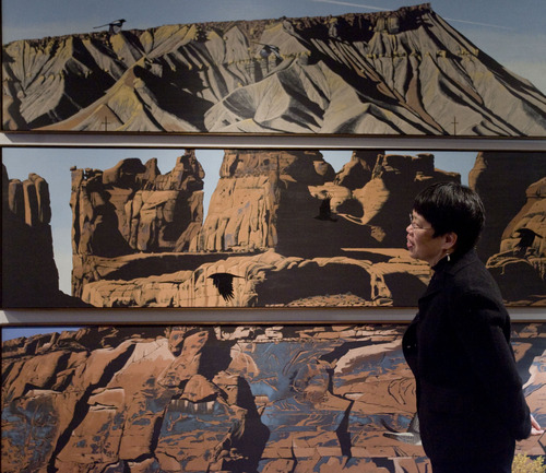 "Kim Raff  |  Tribune file photo University of Utah geology professor Margie Chen admires Mark Knudsen's ""Cliff Face Tryptic"" a series of paintings depicting famous Utah geologic formations. The tryptic was hung recently in the Natural History Museum of Utah."