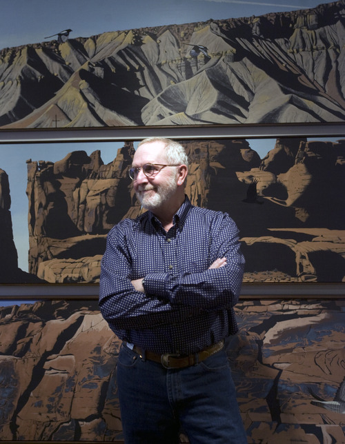Kim Raff  |  Tribune file photo Mark Knudsen, a landscape artist, painted a typtic that depicts famous Utah geologic formations. The tryptic was hung recently in the Natural History Museum of Utah.