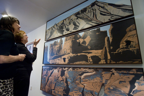 Kim Raff  |  Tribune file photo (left) Anne Peterson and Sarah George, director of the Natural History Museum of Utah, admire Mark Knudsen's tryptic depicting three famous Utah geologic formations. The tryptic was hunt recently in the museum.