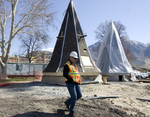 Kim Raff  |  The Salt Lake Tribune A worker walks past a spire that will be used on the construction of the Provo City Center Temple at the construction site in Provo on Thursday. The temple is being rebuilt after a fire in 2010.