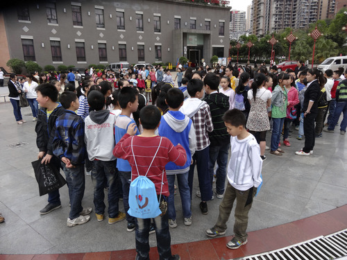 In this photo provided by China's official Xinhua News Agency, students gather outside their school buildings to avoid aftershocks of an earhtquake, in Dazhou,  southwest China's Sichuan Province, Saturday, April 20, 2013. People were killed Saturday when a powerful earthquake jolted China's Sichuan province near the same area where a devastating quake struck five years ago, with state media warning the casualty toll could climb sharply. (AP Photo/Xinhua, Deng Liangkui) NO SALES