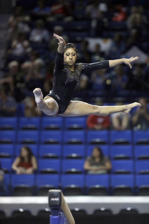 Cassandra Lopez of Utah competes in the ballance beam in the NCAA women's gymnastics championship at UCLA in Los Angeles Friday, April 19, 2013. (AP Photo/Reed Saxon)