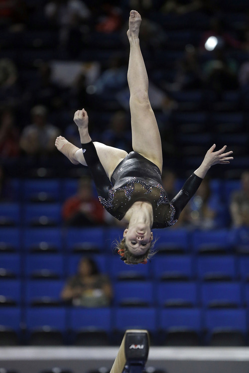 Becky Tutka of Utah competes on the balance beam in the NCAA women's gymnastics championship at UCLA in Los Angeles Friday, April 19, 2013. (AP Photo/Reed Saxon)