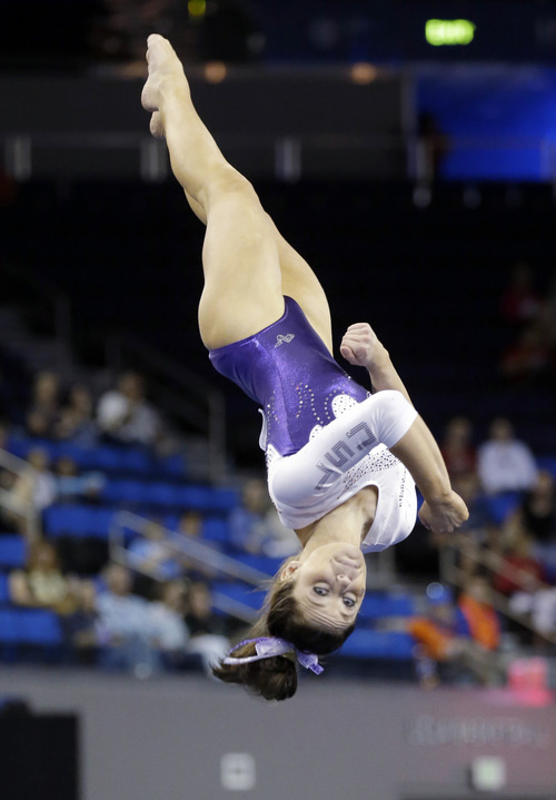Jessie Jordan of LSU competes in the floor exercise in the NCAA women's gymnastics championship at UCLA in Los Angeles Friday, April 19, 2013. (AP Photo/Reed Saxon)