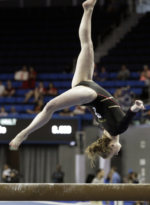 Landsay Mable of Minnesota competes on the balance beam in the NCAA women's gymnastics championship at UCLA in Los Angeles Friday, April 19, 2013. (AP Photo/Reed Saxon)