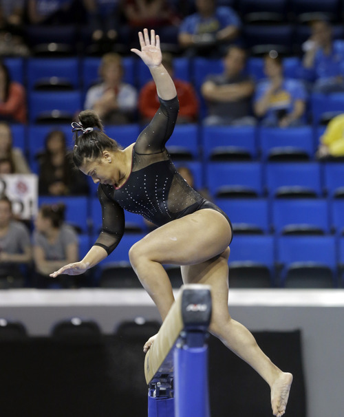 Denver's Moriah Martin falls on the balance beam in the NCAA women's gymnastics championship at UCLA in Los Angeles, Friday, April 19, 2013. (AP Photo/Reed Saxon)