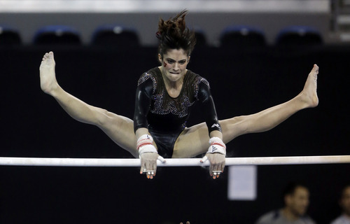 Nansy Damionova of Utah competes on the unevel parallel bars in the NCAA women's gymnastics championship at UCLA in Los Angeles Friday, April 19, 2013. (AP Photo/Reed Saxon)