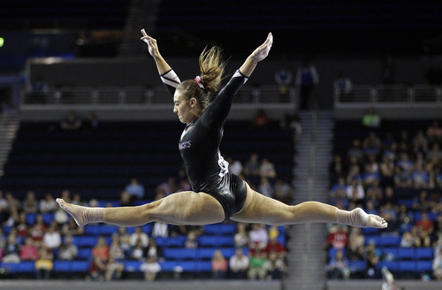 Amy Borsellino of Arkansas competes on the balance beam in the NCAA women's gymnastics championship at UCLA in Los Angeles Friday, April 19, 2013. (AP Photo/Reed Saxon)