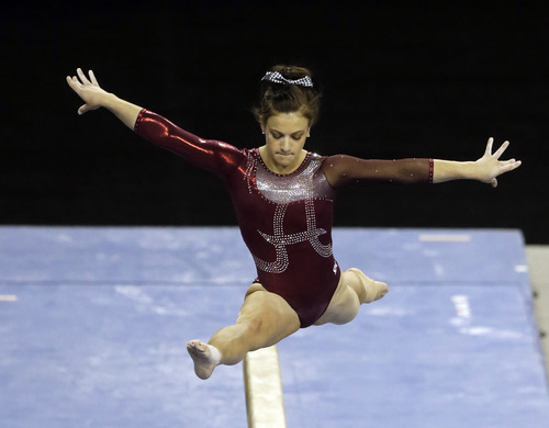 Sarah DeMeo of Alabama competes on the balance beam in the NCAA women's gymnastics championship at UCLA in Los Angeles Friday, April 19, 2013. (AP Photo/Reed Saxon)