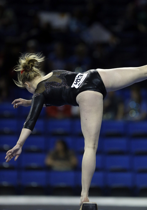 Tory Wilson of Utah falls on the balance beam in the NCAA women's gymnastics championship at UCLA in Los Angeles Friday, April 19, 2013. (AP Photo/Reed Saxon)