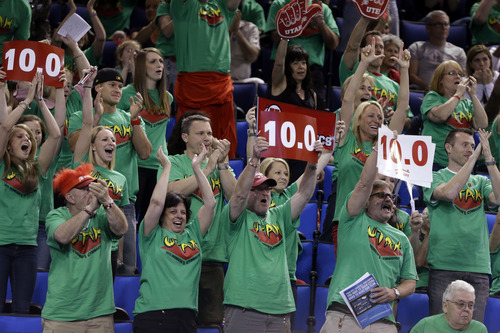Utah fans cheer in the NCAA women's gymnastics championship at UCLA in Los Angeles Friday, April 19, 2013. (AP Photo/Reed Saxon)