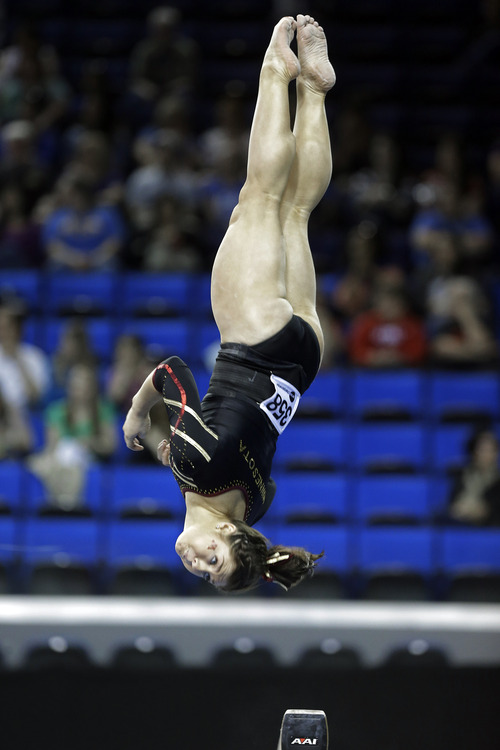 Hanna Nordquist of Minnesota competes on the balance beam in the NCAA women's gymnastics championship at UCLA in Los Angeles Friday, April 19, 2013. (AP Photo/Reed Saxon)