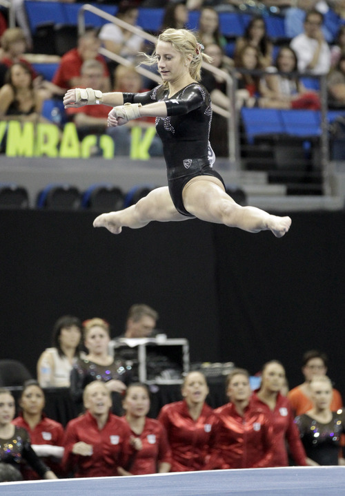 Mary Beth Lofgren of Utah competes in the floor exercise in the NCAA women's gymnastics championship at UCLA in Los Angeles Friday, April 19, 2013. (AP Photo/Reed Saxon)