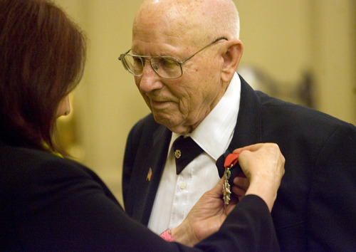 Kim Raff  |  The Salt Lake Tribune Mike Kladis, 91, is awarded the Legion of Honour, for his service in the Army liberating France during World War II, by (left) Marie-Helene Glon, of the Honorary Consul of France, at the Masonic Lodge in Salt Lake City on April 20, 2013.  This award is France's highest honor.
