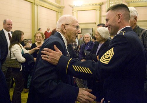 Kim Raff  |  The Salt Lake Tribune (middle) Mike Kladis, 91, is congratulated by people after be awarded the Legion of Honour, for his service in the Army liberating France during World War II, by the Honorary Consul of France at the Masonic Lodge in Salt Lake City on April 20, 2013.  This award is France's highest honor.
