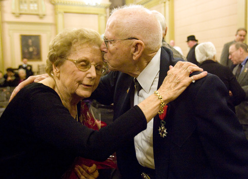 Kim Raff  |  The Salt Lake Tribune (right) Mike Kladis, 91, kisses his wife Ruby Kladis after a ceremony where he was awarded the Legion of Honour, for his service in the Army liberating France during World War II, by the Honorary Consul of France at the Masonic Lodge in Salt Lake City on April 20, 2013.  This award is France's highest honor.