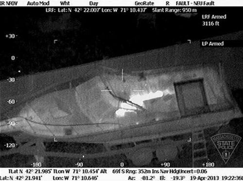 This Friday, April 19, 2013 image made available by the Massachusetts State Police shows 19-year-old Boston Marathon bombing suspect, Dzhokhar Tsarnaev, hiding inside a boat during a search for him in Watertown, Mass. He was pulled, wounded and bloody, from the boat parked in the backyard of a home in the Greater Boston area. (AP Photo/Massachusetts State Police)