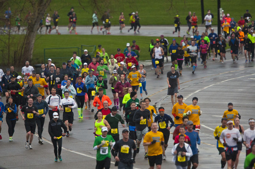 Chris Detrick  |  The Salt Lake Tribune Runners race around Sugar House Park during the Salt Lake City marathon and half marathon Saturday April 20, 2013.
