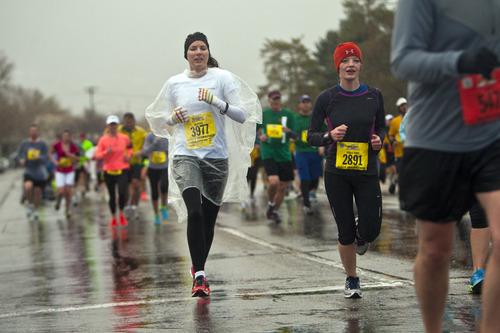 Chris Detrick  |  The Salt Lake Tribune Mercedes Smith, 30, of Salt Lake City, and Jessica Jones, 17, of Bountiful run around Sugar House Park during the Salt Lake City marathon and half marathon Saturday April 20, 2013.