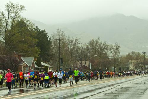 Chris Detrick  |  The Salt Lake Tribune Runners race along 2100 south near Sugar House Park during the Salt Lake City marathon and half marathon Saturday April 20, 2013.