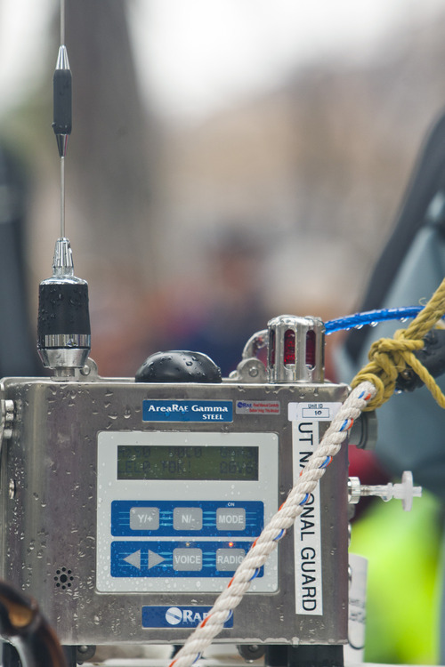 Chris Detrick  |  The Salt Lake Tribune A Utah National Guard explosives and chemical air sniffer at the finish line during the Salt Lake City marathon and half marathon Saturday April 20, 2013.