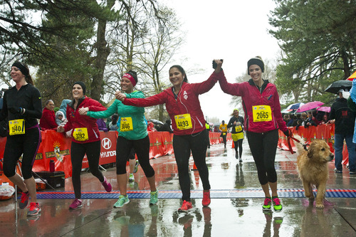 Chris Detrick  |  The Salt Lake Tribune Christy Alexander, Melody Roguschka, Rachel Langer, Shahara Tiatia and Kimber Collins cross the finish line of the Salt Lake City half marathon at Liberty Park Saturday April 20, 2013.