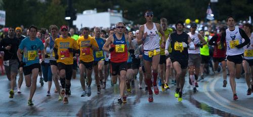Chris Detrick  |  The Salt Lake Tribune Runners race at the start of the Salt Lake City marathon at the University of Utah Saturday April 20, 2013.
