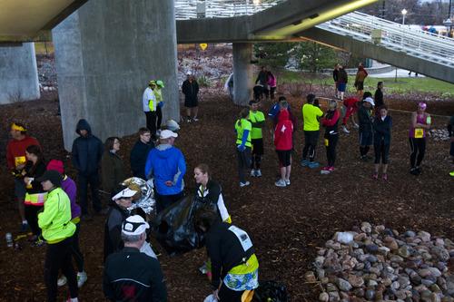 Chris Detrick  |  The Salt Lake Tribune Runners stay dry before the start of the Salt Lake City marathon at the University of Utah Saturday April 20, 2013.