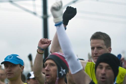 Chris Detrick  |  The Salt Lake Tribune Runners hold up Boston marathon bracelets at the start of the Salt Lake City marathon at the University of Utah Saturday April 20, 2013.