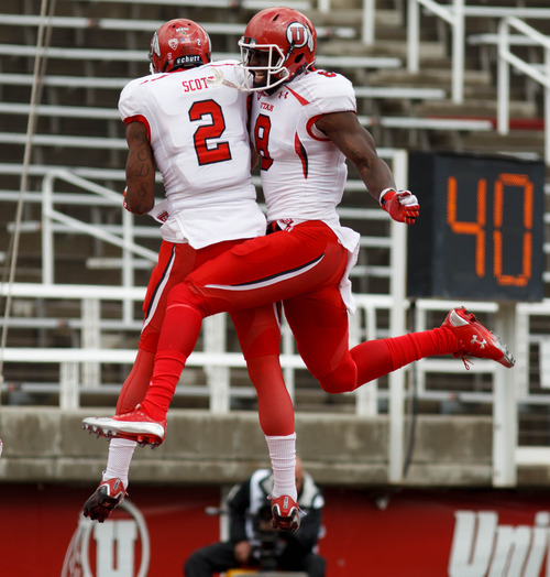 Trent Nelson  |  The Salt Lake Tribune Kenneth Scott and Anthony Denham celebrate Scott's touchdown during the University of Utah's Red-White Spring football game, Saturday April 20, 2013 in Salt Lake City.
