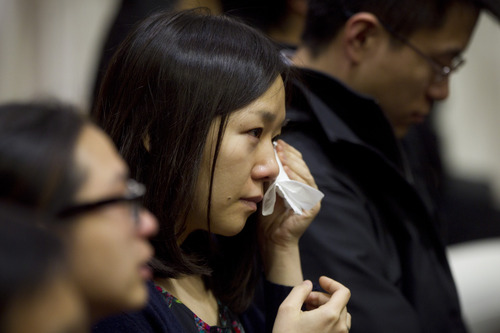 Dina Rudick  |  The Boston Globe via AP A member of the audience sheds tears during Lu Lingzi's eulogy, delivered by her father, Lu June at Metcalf Hall in Boston University's George Sherman Student Union on Monday, April 22, 2013. Lingzi was killed in the Boston Marathon bombings.