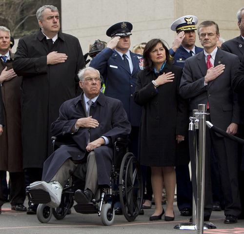 Boston Police Commissioner Edward Davis, left, Boston Mayor Thomas Menino, seated, U.S. Attorney Carmen Ortiz, second from right, and Special Agent in Charge of the FBI's Boston Field Office Richard DesLauriers, right, salute the American flag during a ceremony at the blast site on Boylston Street between Dartmouth and Exeter Streets near the Boston Marathon finish line Monday, April 22, 2013 in Boston. Federal investigators formally released the  finish line bombing crime scene to the city in a brief ceremony at 5 p.m. (AP Photo/Robert F. Bukaty)