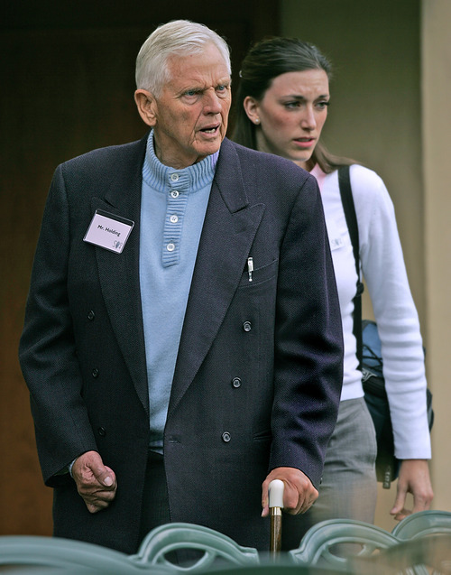 Douglas C. Pizac | Associated Press file photo Sinclair Oil's Earl Holding, accompanied by assistant Elena Baugh, arrives for lunch at the Allen & Co.'s annual media conference Friday, July 9, 2004, in Sun Valley, Idaho.