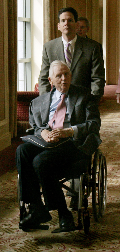 Douglas C. Pizac | Associated Press file photo Earl Holding, of Sinclair Oil, the Grand and Little America hotels, Sun Valley Resort, and former member of the Salt Lake Organizing Committee for the 2002 Winter Olympics, is wheeled to a fundraising luncheon for Republican presidential candidate, Sen. John McCain, R-Ariz., Thursday, March 27, 2008, in Salt Lake City.
