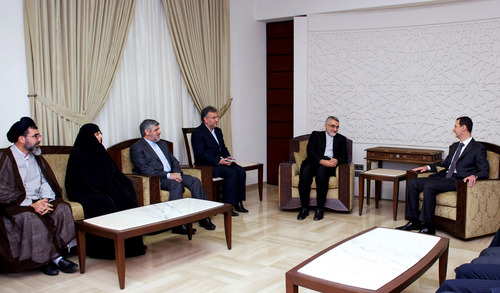 In this photo released by the Syrian official news agency SANA, Syrian President Bahsar Assad, right, speaks during a meeting with Alaeddin Boroujerdi, second left, head of Iran's parliamentary committee on national interest and foreign policy, in Damascus, Syria, Monday, April 22, 2013. Assad said during the meeting that the Middle East is being subjected to plans that targets its stability and unity of its territories. (AP Photo/SANA)