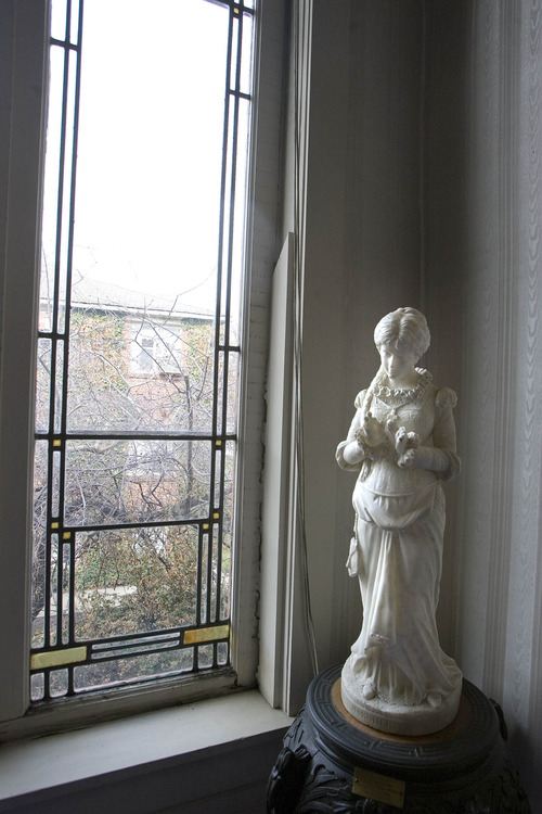 Paul Fraughton  |  The Salt Lake Tribune A statue stands near one of the original windows at the Ladies' Literary Club.  Tuesday, April 2, 2013
