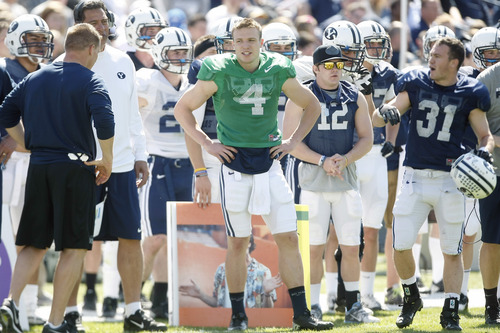 Chris Detrick  |  The Salt Lake Tribune Brigham Young Cougars quarterback Taysom Hill (4) watches during the spring scrimmage at LaVell Edwards Stadium Saturday March 30, 2013.