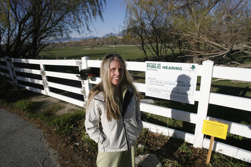 Rick Egan  | The Salt Lake Tribune   Angela Healy stands near the northern stub accesses the Jordan River Parkway which is across the street from her home in Riverton, Thursday, April 18, 2013.  Residents of Reeves Lane in Riverton have petitioned the addition of a throughway to a dead end on their northern end, the result of and Ivory Homes housing development in planning.