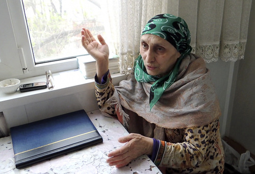 "In this image taken from a video, Patimat Suleimanova, the aunt of USA Boston bomb suspects, speaks to The Associated Press in her home in the Russian city of Makhachkala, Monday April 22, 2013.  Suleimanova says Tamerlan Tsarnaev  struggled to find himself while trying to reconnect with his Chechen identity on a trip to Russia last year.  He ""seemed to be more American"" than Chechen and ""didn't fit into the Islamic world,"" she said.(AP Photo/AP Television)"