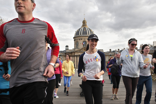 Runners participate in a 3 mile run through the streets of Paris to show support for the USA city of Boston,  Monday, April 22, 2013, in the wake of the recent bombings at the Boston Marathon. The run was specially organized to show solidarity with the victims in Boston. (AP Photo/Thibault Camus)