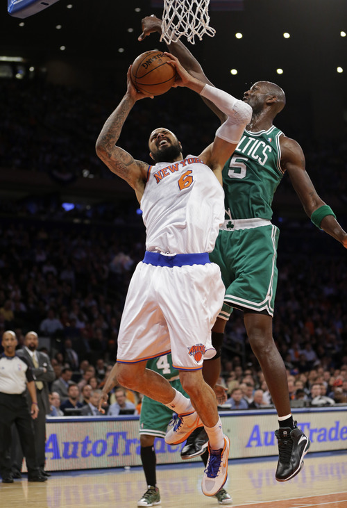 Boston Celtics center Kevin Garnett (5) defends against New York Knicks center Tyson Chandler (6) in the first half of Game 2 of their first-round NBA basketball playoff series in New York, Tuesday, April 23, 2013. (AP Photo/Kathy Willens)