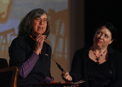 Rick Egan  | The Salt Lake Tribune   Joan Gregory, Peaceful Uprising, introduces Tim DeChristopher after the screening of the film Bidder 70, at the Tower Theater, Monday, April 22, 2013. Tori Baker from the Salt Lake Film Society is the moderator on the right.