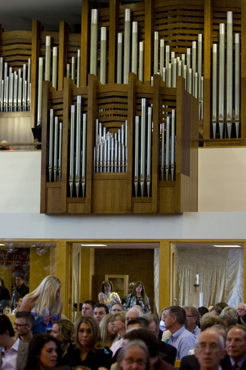 Kim Raff  |  The Salt Lake Tribune People find their seats for the Easter Sunday Mass in the sanctuary of  St. Ambrose Catholic Church in Salt Lake City on March 31, 2013.  The church just completed the installation of the Roper Memorial Pipe Organ which is situated in the balcony of the sanctuary.