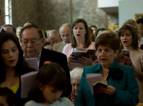 Kim Raff  |  The Salt Lake Tribune People stand and sing as the newly installed Roper Memorial Pipe Organ plays a hymn at St. Ambrose Catholic Church during Easter Sunday Mass in Salt Lake City on March 31, 2013.