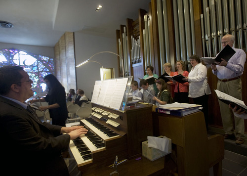 Kim Raff  |  The Salt Lake Tribune Members of the choir of St. Ambrose Catholic Church sing as the newly installed Roper Memorial Pipe Organ is played in the sanctuary during Easter Sunday Mass in Salt Lake City on March 31, 2013.