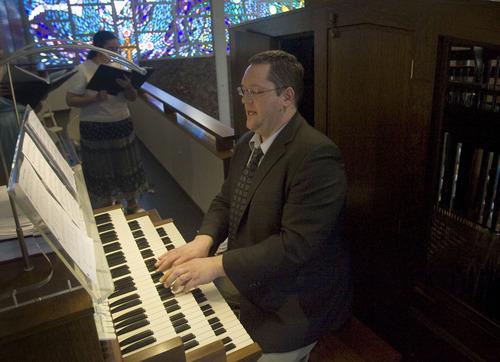 Kim Raff  |  The Salt Lake Tribune Music director Chris Huntzinger plays the newly installed Roper Memorial Pipe Organ at St. Ambrose Catholic Church during Easter Sunday Mass in Salt Lake City on March 31, 2013.
