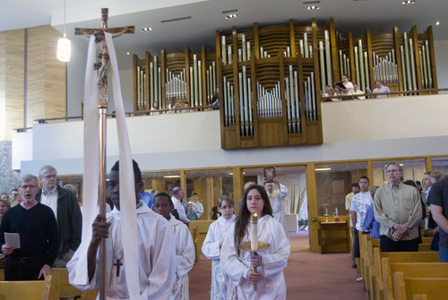 Kim Raff  |  The Salt Lake Tribune The newly installed Roper Memorial Pipe Organ plays the Processional Hymn at St. Ambrose Catholic Church during Easter Sunday Mass in Salt Lake City on March 31, 2013.