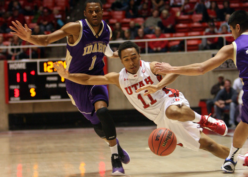 Kim Raff     The Salt Lake Tribune University of Utah guard Brandon Taylor (11) is tripped up while dribbling the ball down the court past College of Idaho player Rodney Delgardo during a game at the Huntsman Center in Salt Lake City on December 28, 2012.